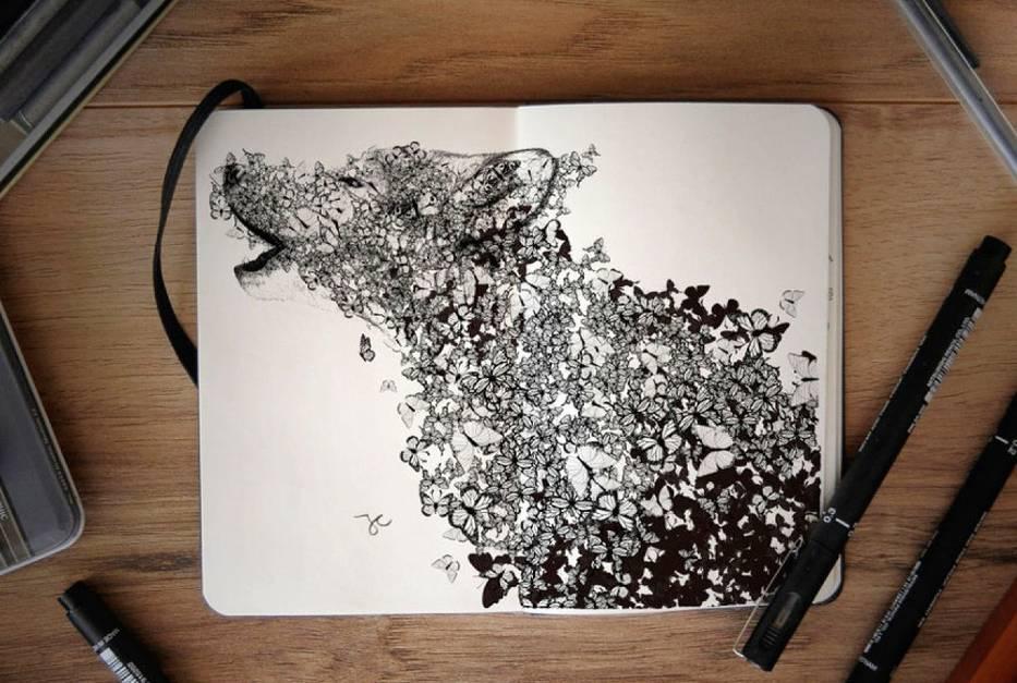 Surrealistyczne rysunki w notatniku