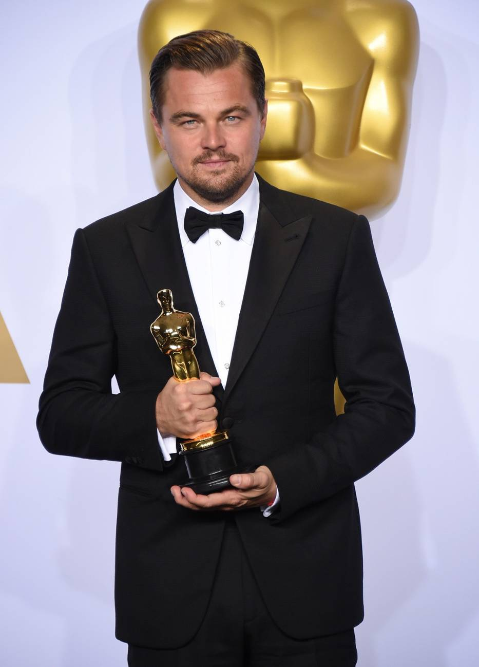 "Leonardo dicaprio poses in the press room with the award for best actor in a leading role for ""the revenant"" at the oscars on sunday, feb"
